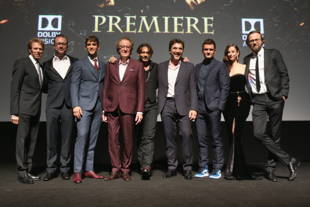 "(Photo by Jesse Grant/Getty Images for Disney) HOLLYWOOD, CA - MAY 18: (L-R) Producer Jerry Bruckheimer, Director Espen Sandberg, actors Brenton Thwaites, Geoffrey Rush, Johnny Depp, Javier Bardem, Orlando Bloom, Kaya Scodelario and Director Joachim Ronning at the Premiere of Disney's and Jerry Bruckheimer Films' ""Pirates of the Caribbean: Dead Men Tell No Tales,"" at the Dolby Theatre in Hollywood, CA"